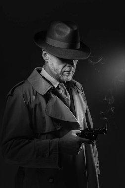 Detective holding gun