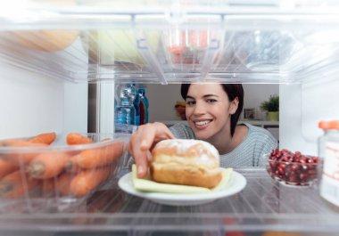 Woman having  unhealthy snack