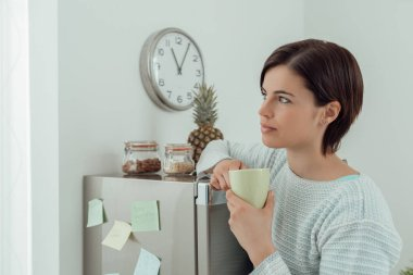 Young woman having a coffee break