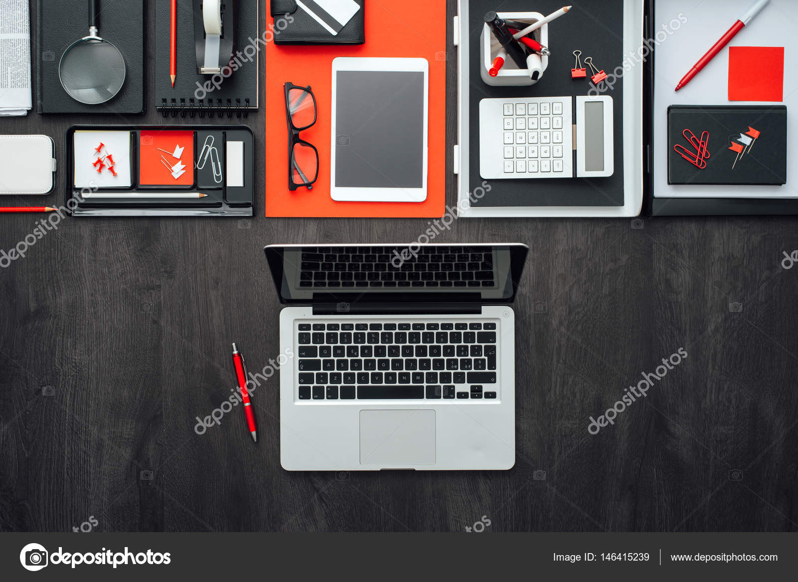 business desktop with office accessories and laptop stock photo