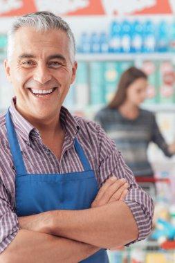 supermarket clerk posing at shopping mall