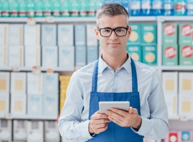 Supermarket clerk using tablet