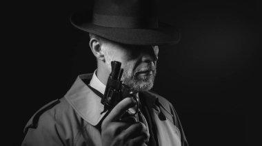 Detective holding gun in dark