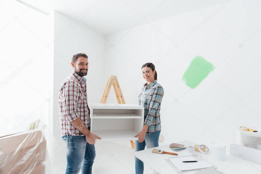 Couple moving furnishings together