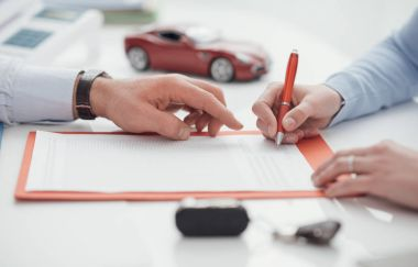 agent helping at woman signing policy