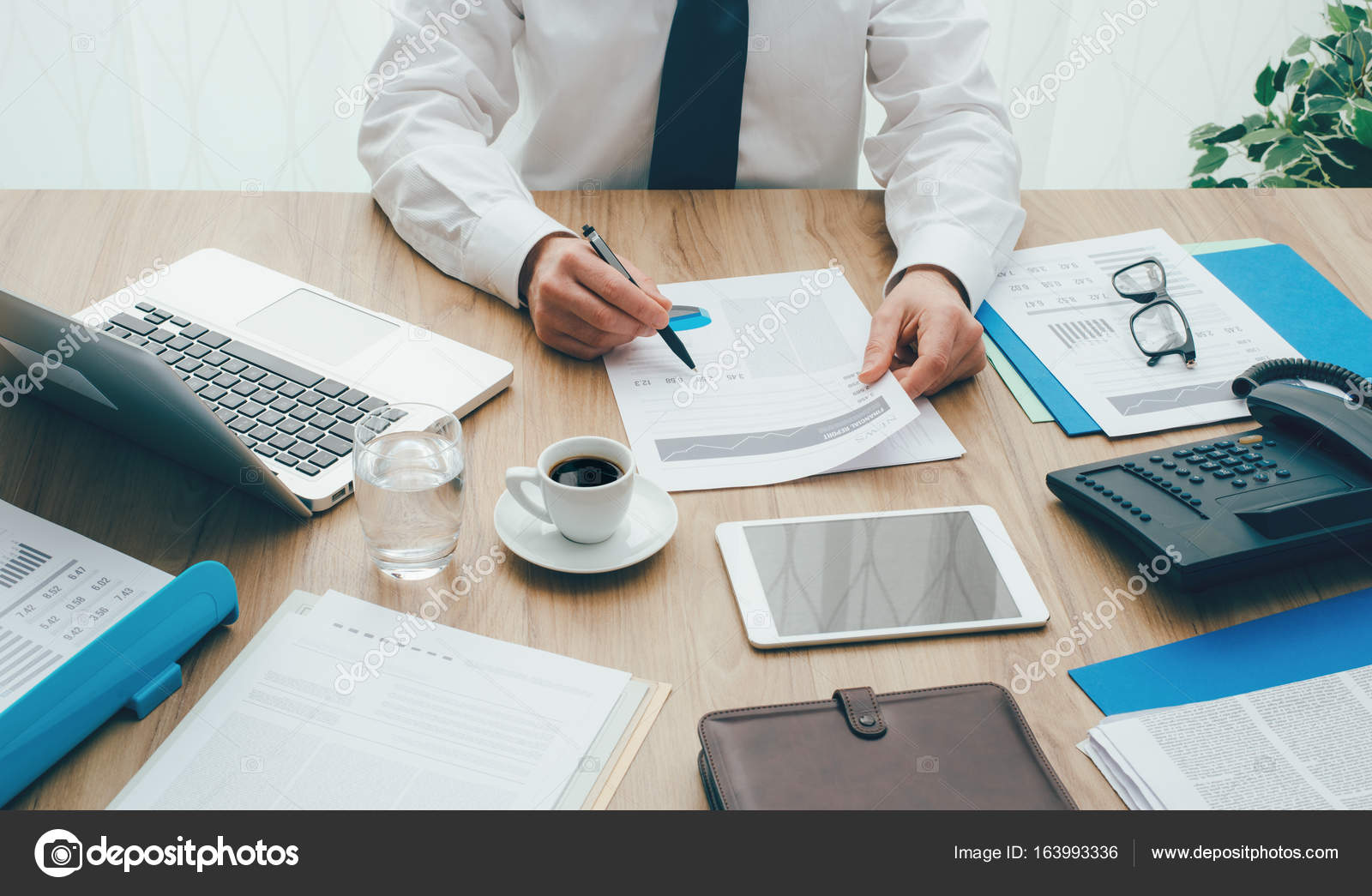 office working table aesthetically businessman working at office desk stock photo businessman stokkete 163993336