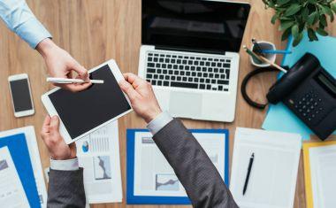 Business people using digital tablet