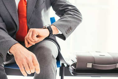 Corporate businessman checking time