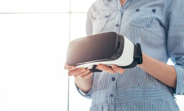 Woman holding VR headset