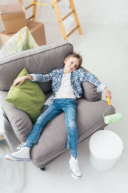 Lazy boy lying on armchair