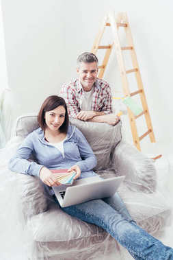 Couple connecting with laptop