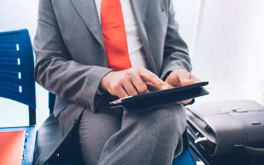 Businessman connecting with tablet