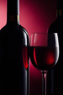 wine bottle and full wineglass