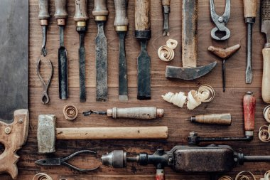 Set of vintage carpentry tools on a old workbench: woodworking, craftsmanship and handwork concept, flat lay
