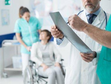professional doctors examining x-ray