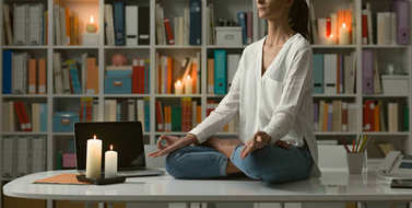 woman practicing meditation at home