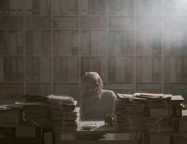 Overloaded stressed senior office worker