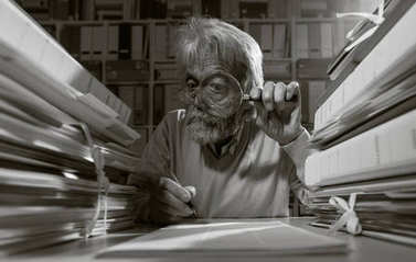 Senior researcher using magnifier glass