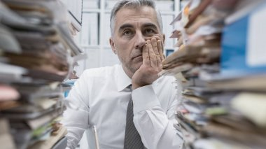 overwhelmed businessman working in office