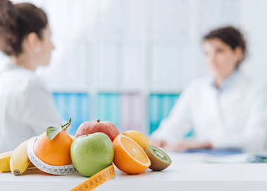 Professional nutritionist meeting patient