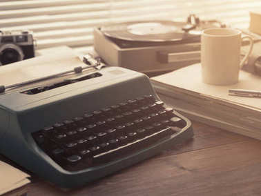 Writer, journalist and photoreporter vintage desktop with typewriter, camera and record player