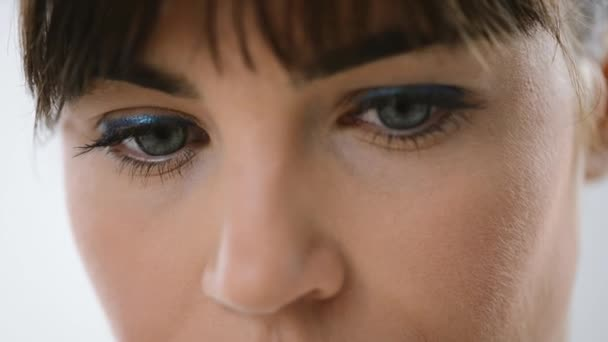 Womans blue eyes close up