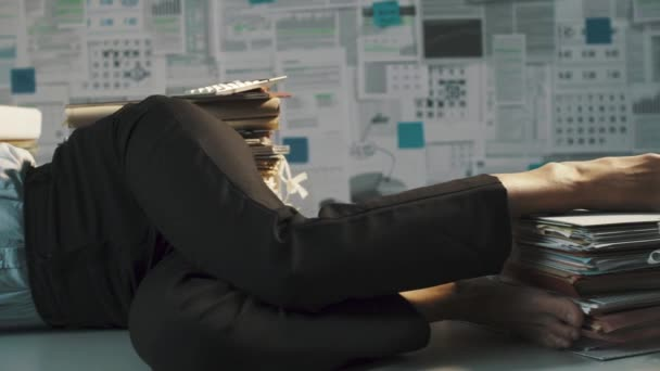 Exhausted businesswoman sleeping on the desk