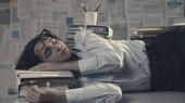 Business executive sleeping on the desk
