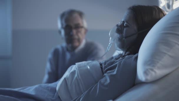 Man checking a sick woman at the hospital