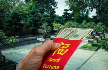 Chinese Bonsai garden and red envelope or hong bao during Chinese New Year in China and Taiwan