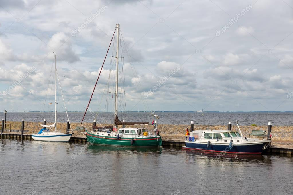 Harbor historic Dutch village Urk with modern sailing yachts