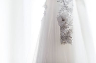 White wedding dress. Wedding detail photography
