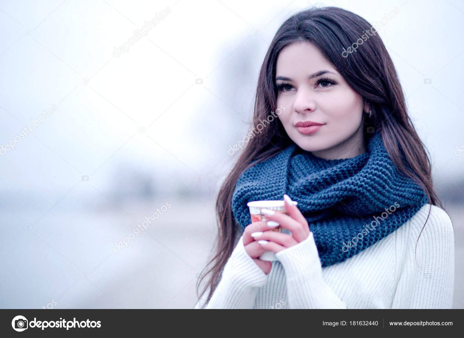 30c335e12b Beautiful young woman with a cup of coffee in winter in a sweater and with  a scarf — Photo by mikaeva666.gmail.com