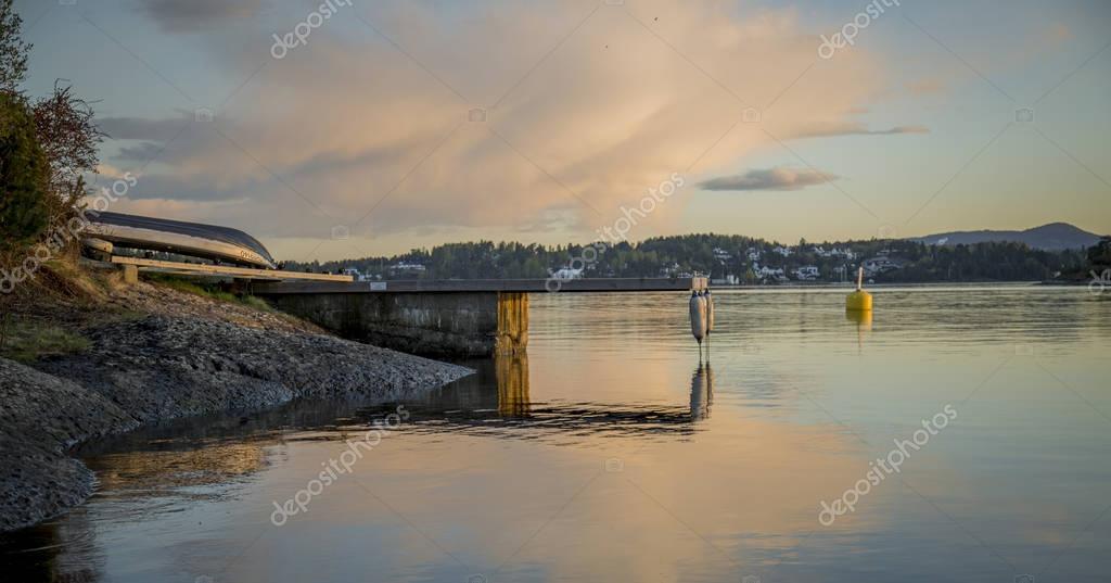 Sunset sea coast with boat