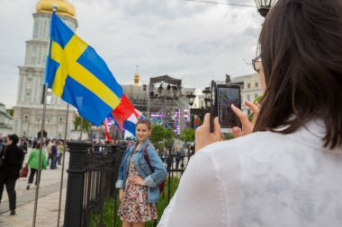 KYIV, UKRAINE - APRIL 30, 2017: People on Sofiivska Square near Eurovision song contest  fan zone in Kyiv, Ukraine stock vector