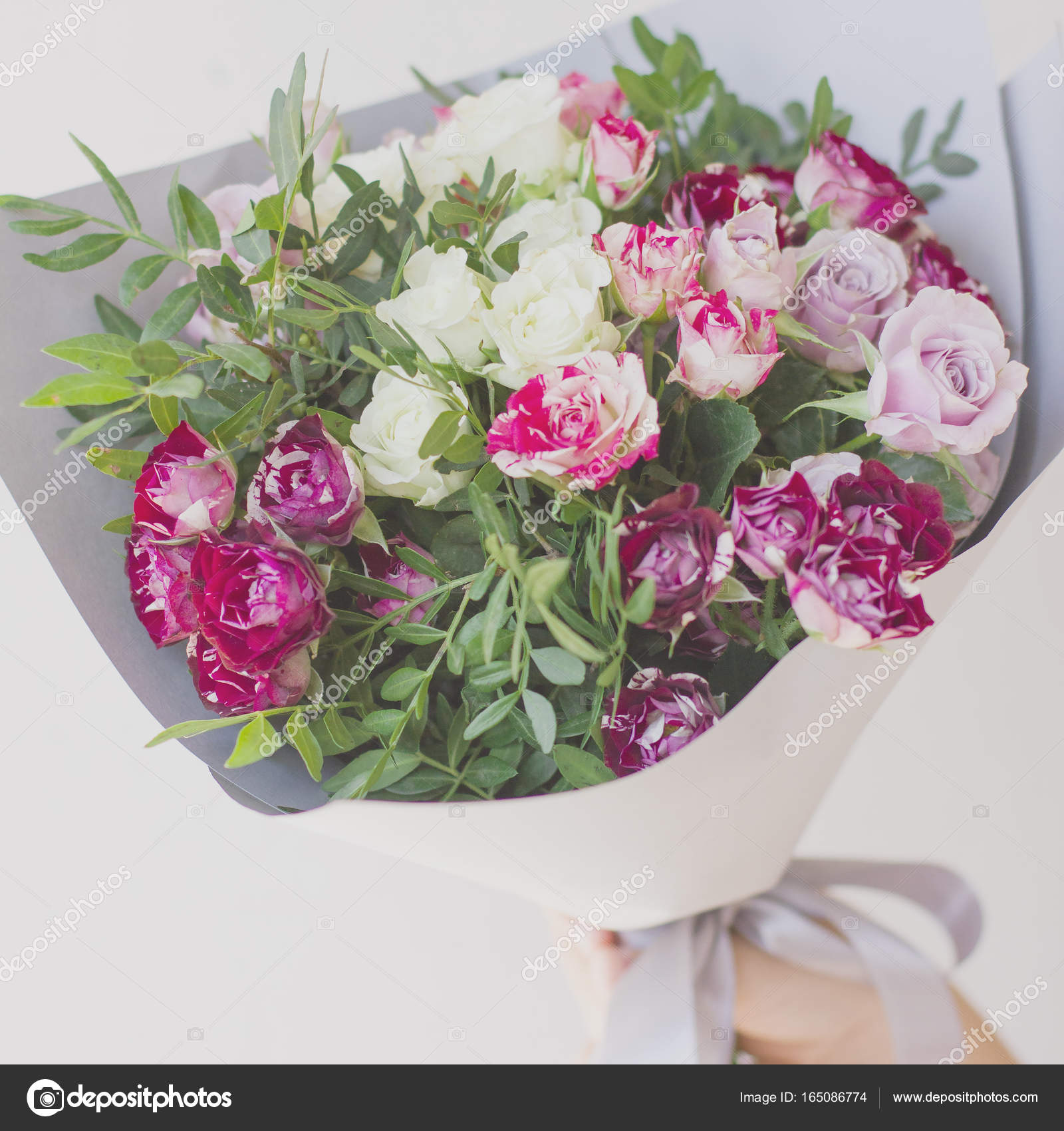 The Bouquet Of Pink Spray Roses In The Gray Paper Stock Photo