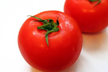 Juicy fresh tomato on a white background