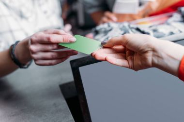 girl paying with credit card