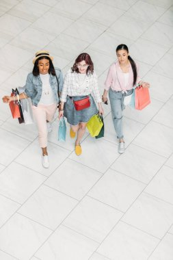 Young women with shopping bags