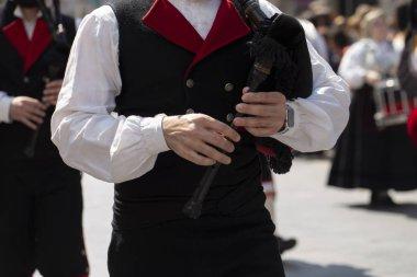 Man playing a bagpipe