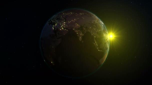 Realistické země, otočení v prostoru na pozadí hvězdné oblohy a slunce (smyčka). Na planetě Zemi je změna za dne i v noci, s správnou rotaci v nekonečnou smyčku. Existují města, s noční osvětlení