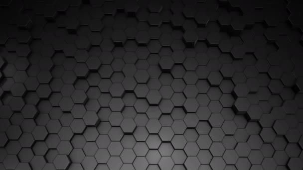 Eine abstrakte sechseckige geometrische schwarze Oberfläche bewegt sich zyklisch im virtuellen Raum. Chaotische Schwingungen geometrischer Formen. Schaffung einer dynamischen Wand aus Sechsecken