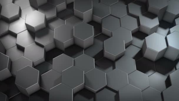 Eine abstrakte sechseckige geometrische metallische Oberfläche bewegt sich zyklisch im virtuellen Raum. Chaotische Schwingungen geometrischer Formen. Schaffung einer dynamischen Wand aus Sechsecken