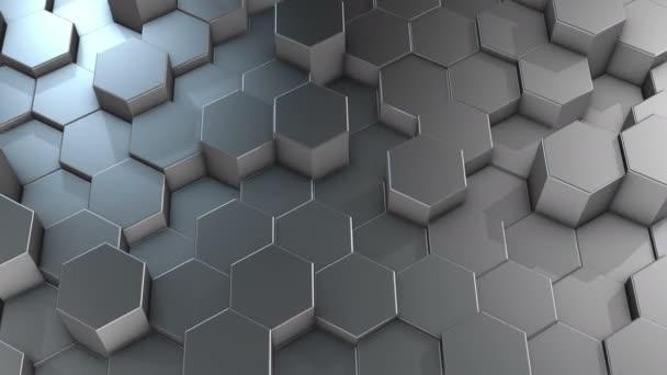 Eine abstrakte sechseckige geometrische Aluminiumoberfläche bewegt sich zyklisch im virtuellen Raum. Chaotische Schwingungen geometrischer Formen. Schaffung einer dynamischen Wand aus Sechsecken