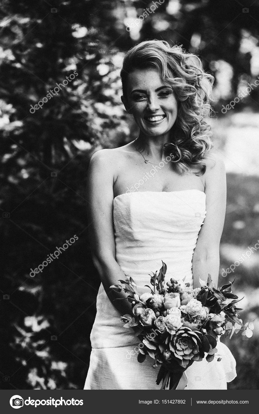 Bride Posing With Bouquet Of Flowers Stock Photo Andreygribov