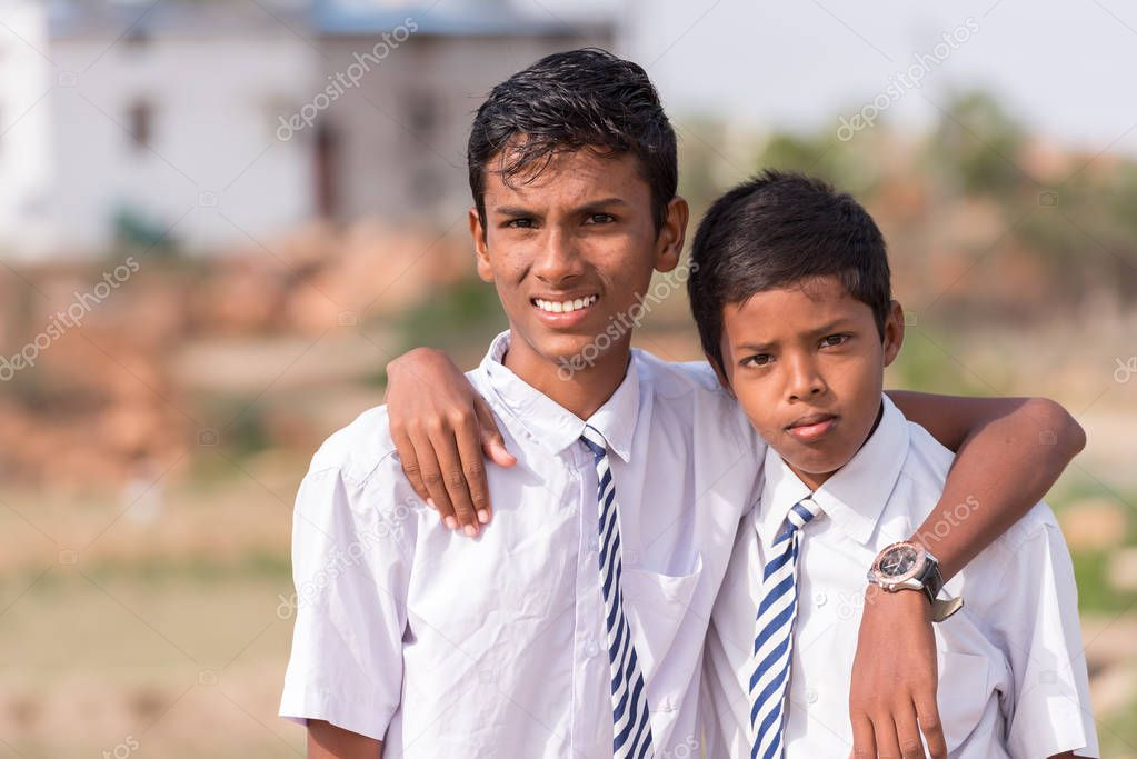 PUTTAPARTHI, ANDHRA PRADESH, INDIA - JULY 9, 2017: Portrait of two Indian boys. Close-up.