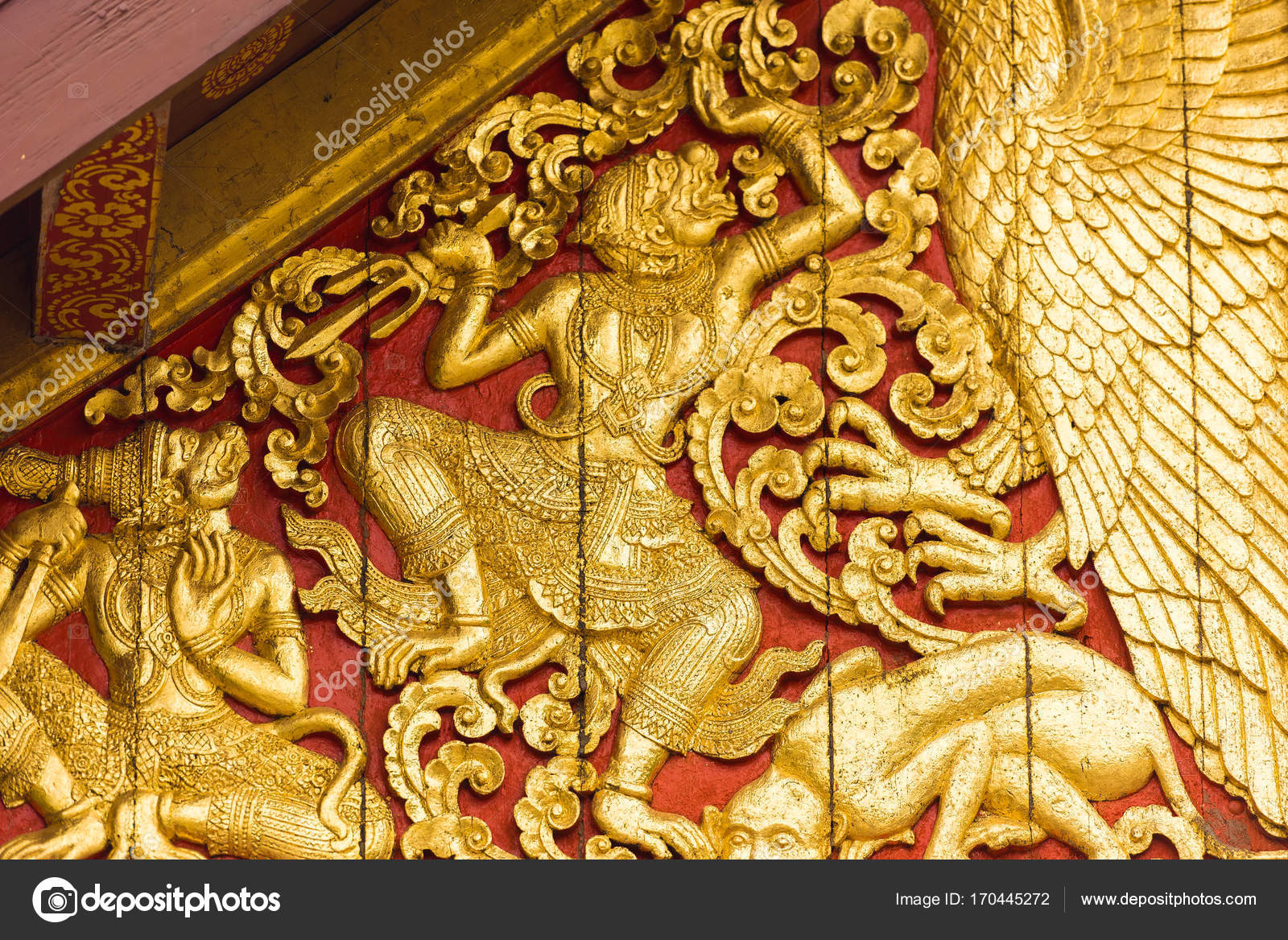 The bas-relief on the wall of the temple in Louangphabang, Laos ...