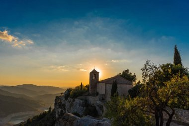 View of the Romanesque church of Santa Maria de Siurana at sunset in Siurana de Prades, Tarragona, Spain. Copy space for text.