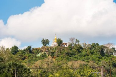 View of the Buddhist temple on the mountain, Louangphabang, Laos. Copy space for text.