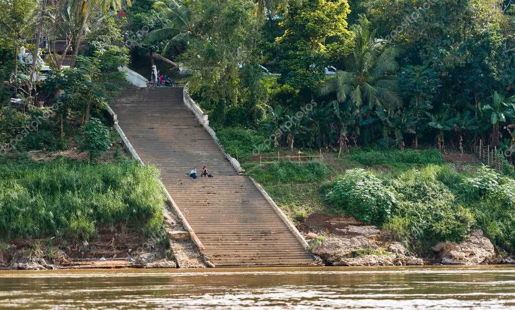 LUANG PRABANG, LAOS - JANUARY 11, 2017: The staircase on the bank of the river Nam Khan. Copy space for text.